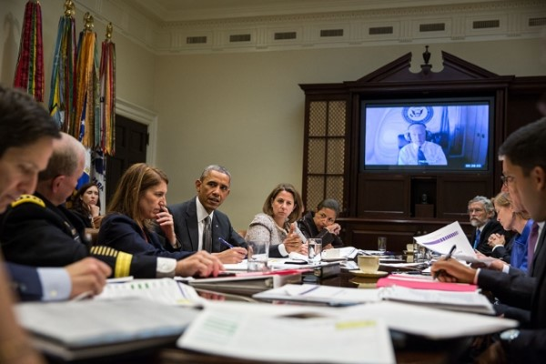 President Barack Obama meets with members of his national security team and senior staff to receive an update on the Ebola outbreak in West Africa and the Administration's response efforts, in the Roosevelt Room of the White House, Oct. 6, 2014. Vice President Joe Biden participates via secure video conference. (Official White House Photo by Pete Souza)