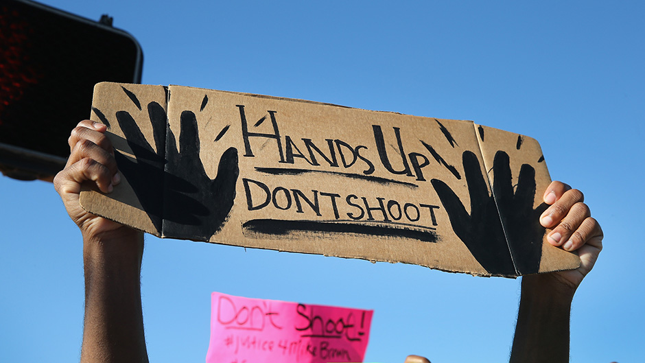 2014-08-18-protestsignoverfergusonshootingdata