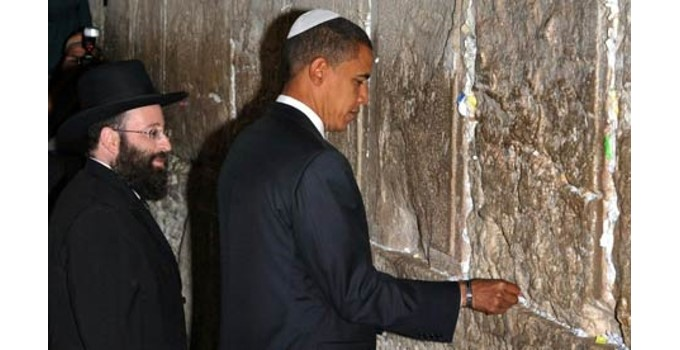 Obama wearing a yarmulke while praying with Jews at the Western Wall in Jerusalem