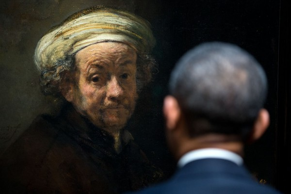 """POTUS meets Rembrandt. The President looks at Rembrandt's 'Self-portrait as the Apostle Paul' during a tour of the Gallery of Honor at the Rijksmuseum in Amsterdam, the Netherlands."" (Official White House Photo by Pete Souza)"