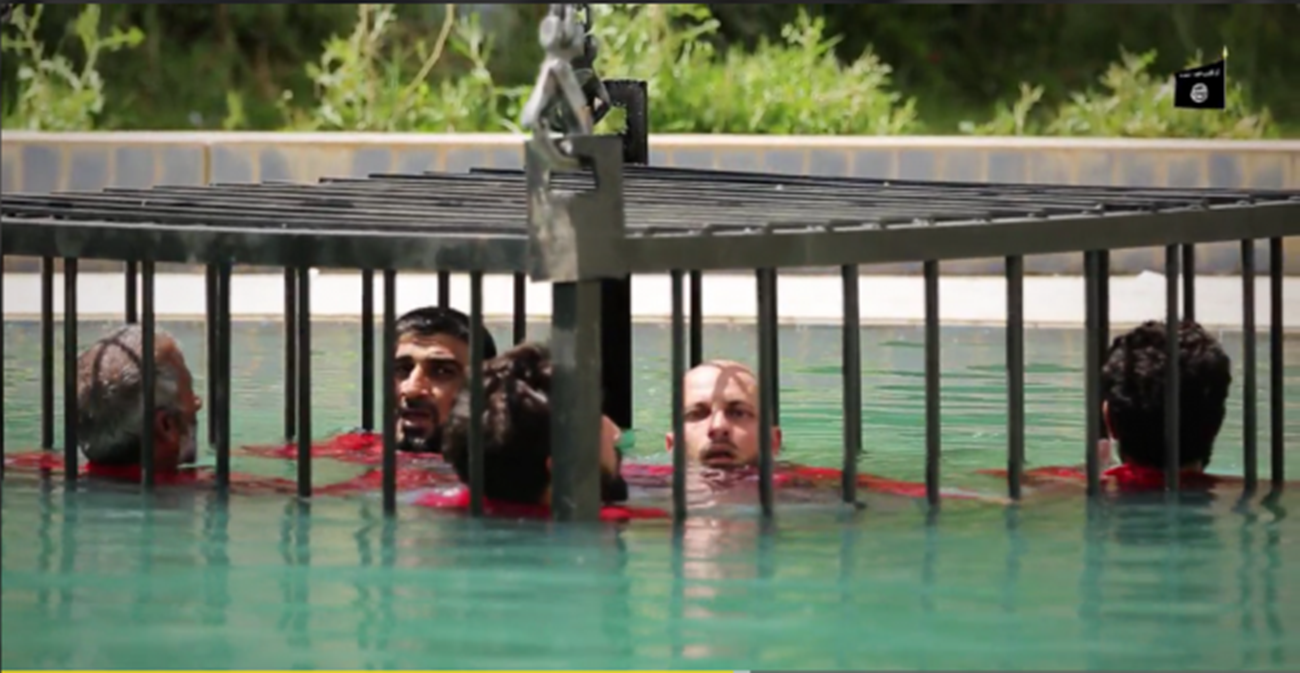 Sickening New ISIS Video Shows Caged Prisoners Drowned in ...