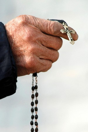 The new missal's translation of the Apostle's Creed, used at the beginning of the rosary and during baptism, will have a few changes in the new missal's translation. (CNS photo/Reuters)