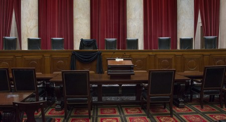 The bench chair of Supreme Court Justice Antonin Scalia, who died Saturday, is draped in black. | Getty