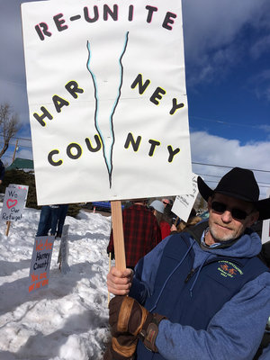 Burns resident Leon Pielstick carries a sign outside the Harney County Courthouse on Monday. Martin Kaste/NPR