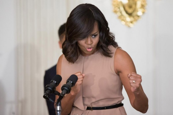 """First lady Michelle Obama jokes with members of the audience as she speaks in the State Dinning Room at the White House in Washington, Wednesday, Feb. 24, 2016, during an interactive student workshop on the musical legacy of Ray Charles, where students from 10 schools and community organizations from across the country participate as part of the """"In Performance at the White House"""" series. (AP Photo/Andrew Harnik)"""
