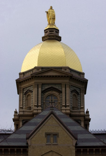 The Golden Dome with its statue of Mary is seen in a 2003 file photo atop the administration building of the University of Notre Dame in Notre Dame, Ind. (CNS photo/Karen Callaway, Northwest Indiana Catholic) (Dec. 10, 2012)