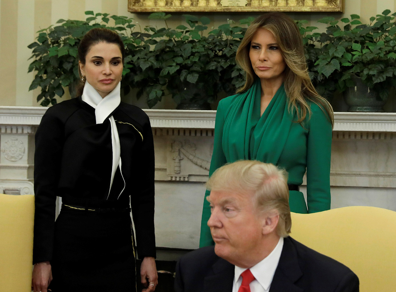 U.S. first lady Melania Trump and Jordan's Queen Rania (L) look on as U.S. President Donald Trump meets with King Abdullah of Jordan (not pictured) at the White House in Washington, D.C. on April 5, 2017. (Photo: Kevin Lamarque/Reuters)